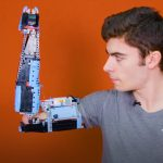 Teenager makes an arm out of Lego