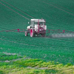 Glyphosfate spraying with a tractor on farm land